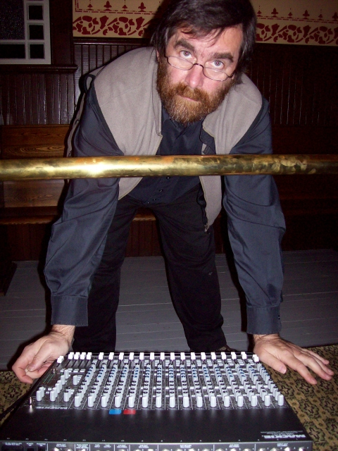 image of Dean Verger standing over the sound board