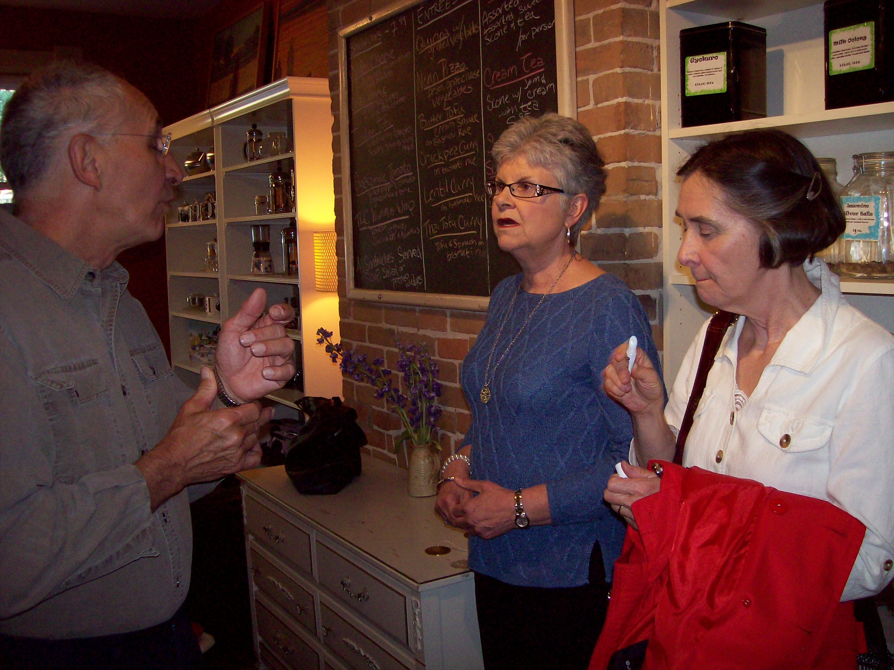 photo of mary and kathie speaking with bob