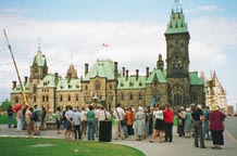 People congregated around the Eternal Flame on Parliament Hill